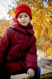 Girl with red hat. At autumn Royalty Free Stock Image