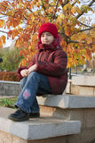 Girl with red hat. At autumn Stock Image