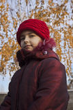 Girl with red hat. At autumn Stock Images