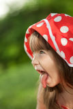 Girl in a red hat Stock Images