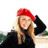 A Girl in a Red Hat Stock Photo