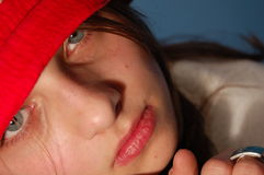Girl with red hat. With no smile royalty free stock photography