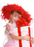 Girl in the red hat. Girl in the red hat whith gift box Stock Images