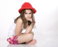 Girl in Red Hat Stock Photo