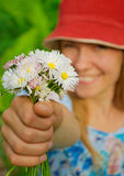 Girl in red hat with daisies Royalty Free Stock Photos