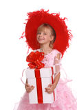 Girl in red hat and gift box. Isolated Royalty Free Stock Photos