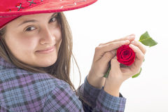 Girl with red hat holding a red rose isolated on white Stock Photos