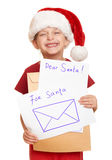 Girl in red hat with letter to santa - winter holiday christmas concept Stock Image
