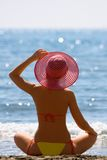 Girl with a red hat is on sea coast Royalty Free Stock Photography