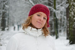 Girl in red hat on snowy day Royalty Free Stock Photos