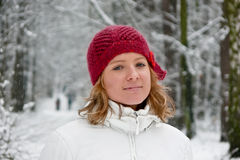Girl in red hat on snowy day Royalty Free Stock Photo