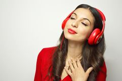 Girl with red headphone close her eyes and chill out with her favorite song on white background. Copy space. Girl with red headphone close her eyes and chill Royalty Free Stock Image