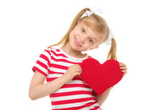Girl with red heart. Isolated on white Royalty Free Stock Image