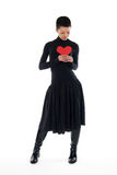 Girl with red heart Stock Images