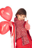 Girl with red heart balloon Stock Image