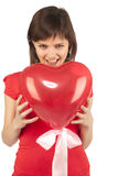 Girl with red heart balloon Royalty Free Stock Photography