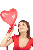 Girl with red heart balloon Stock Photo
