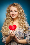 Girl with red heart. Concept of Valentine's Day Royalty Free Stock Photography