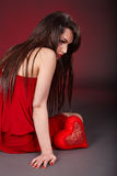 Girl with red heart  in depression. Stock Images