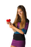 Girl with red heart in hands Stock Photos