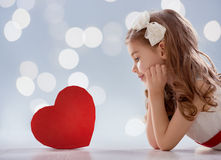 Girl with red heart royalty free stock image