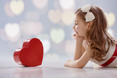 Girl with red heart stock photo
