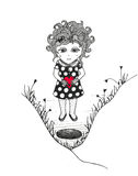 Girl with red heart near the hole Stock Photos