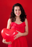 Girl and Red Heart Shaped Balloon Royalty Free Stock Photo