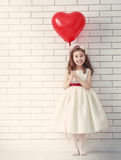 Girl with red heart royalty free stock photo