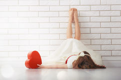 Girl with red heart royalty free stock photography