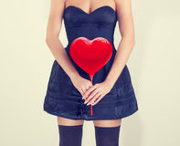 Girl with red hearts hands. Royalty Free Stock Photography