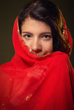Girl in red hijab. Smiling girl in red hijab looks at camera Royalty Free Stock Photo