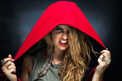 Girl in Red Hood and Makeup Scowling royalty free stock photography
