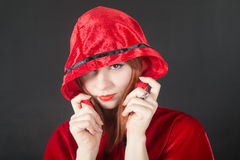 Girl in a red hood Royalty Free Stock Image