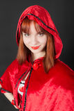 Girl in a red hood Stock Photography