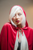 Girl in red hood Stock Photos