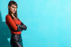 Girl in a red jacket and black skirt Royalty Free Stock Photo