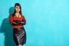 Girl in a red jacket and black skirt Royalty Free Stock Photos