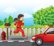 A girl in a red jacket and pants running Royalty Free Stock Image