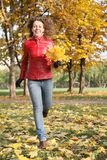 Girl in the red jacket in the park Royalty Free Stock Image