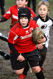 Girl with red jacket play rugby Stock Photo