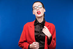 Girl in a red jacket with red lips Royalty Free Stock Photo
