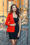 Girl in a red jacket with scarlet lips. Stock Image