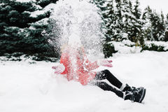 Girl in a red jacket in winter Stock Images