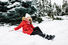 Girl in a red jacket in winter Royalty Free Stock Images