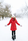 Girl in a red jacket in winter Stock Photography