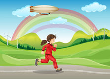 A girl in red jogging Royalty Free Stock Image