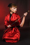 Girl in red kimono with katana Royalty Free Stock Photography