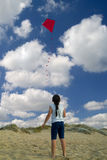 Girl and red kite Stock Photo