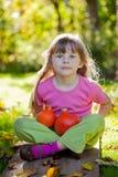 Girl with red kuri squash Stock Photo